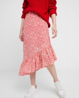 Woman wearing pink flowered skirt with red pullover