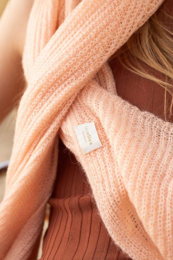 Detail of a soft peach scarf