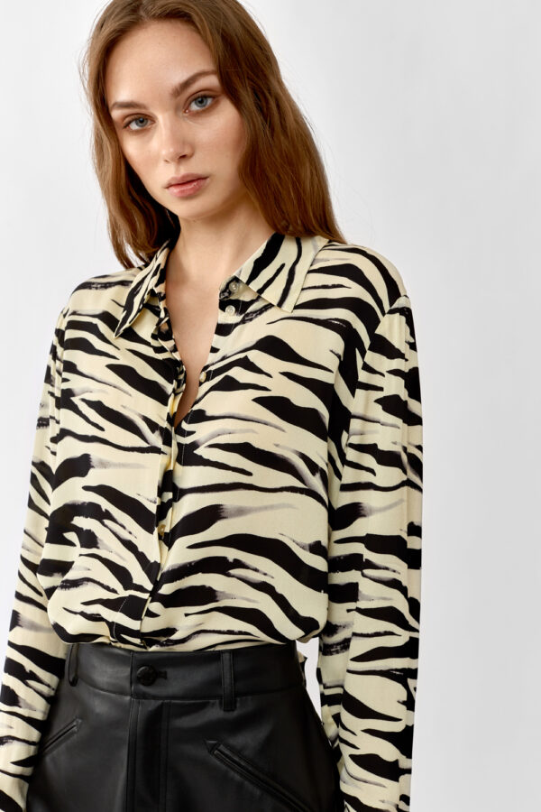 Woman wearing a yellow zebra printed shirt