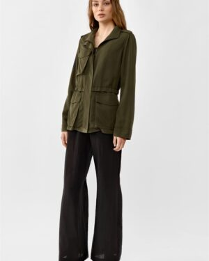 Woman wearing a Khaki green parka jacket in tencel