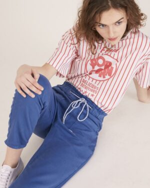 Woman wearing blue casual trousers with a striped t-shirt