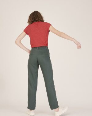 Woman wearing green trousers and a red t-shirt back