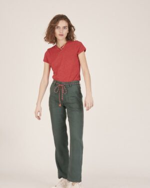 Woman wearing green trousers and a red t-shirt