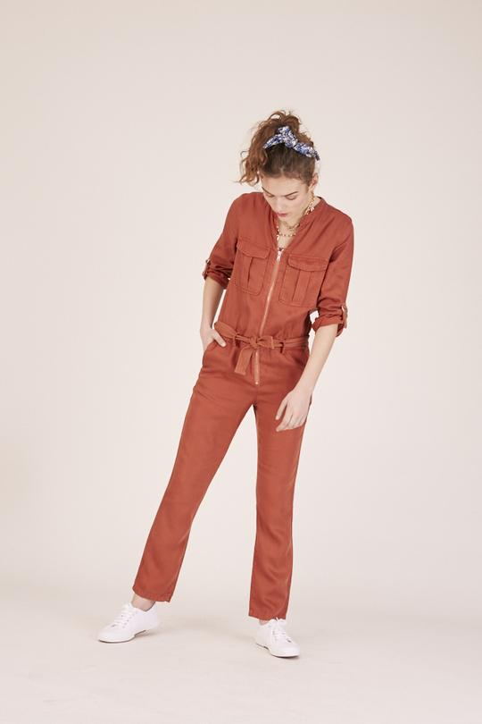 Woman wearing a red jumpsuit