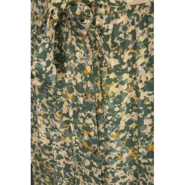 Detail of Long green camouflage print skirt