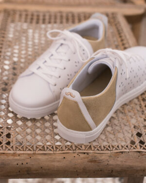 White perforated sneakers with golden back