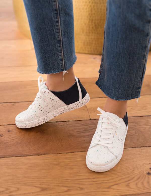 White navy sneakers with paint stains
