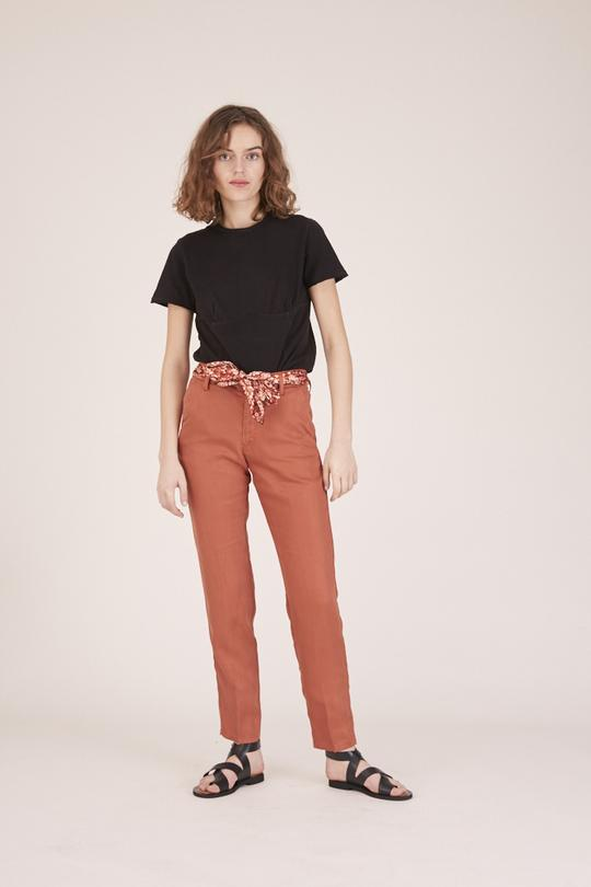Woman wearing red trousers and a black t-shirt