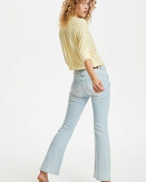 Woman wearing light blue Torina bootcut jeans