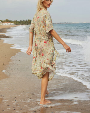 Woman on the beach wearing Hawaii shirt dress