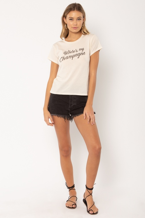 """Woman wearing black shorts and a white t-shirt with """"Where's my Champagne"""""""