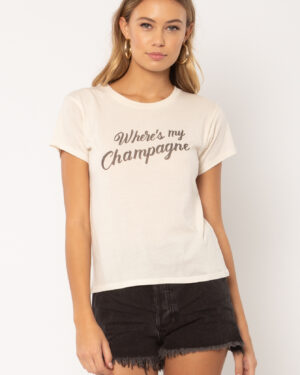 """Woman wearing a white t-shirt with """"Where's my Champagne"""""""