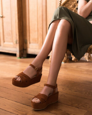 Woman-wearing-Cognac-suede-wedge-sandals