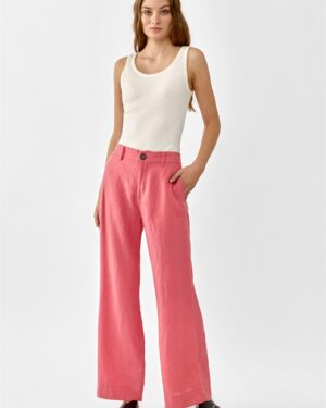 Women wearing pink linen trousers an a white top