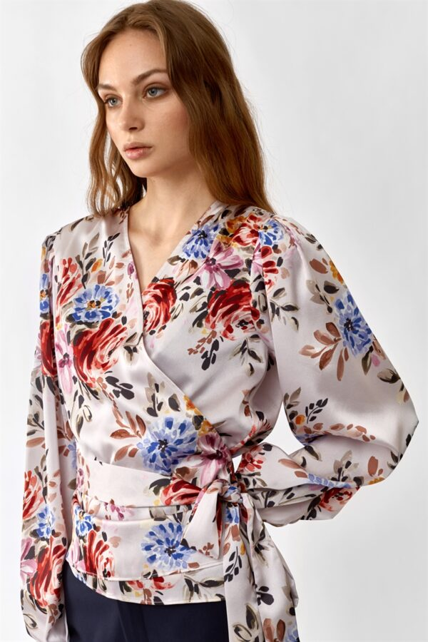 woman wearing a pink flowered wrap blouse