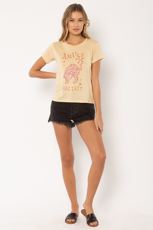 Woman wearing Wild Me t-shirt from Amuse Society and black shorts