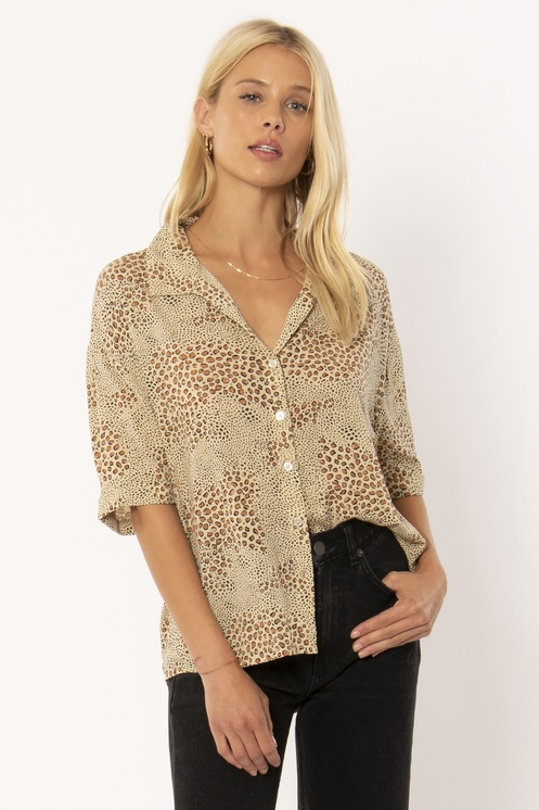 Blonde woman wearing wildcat blouse