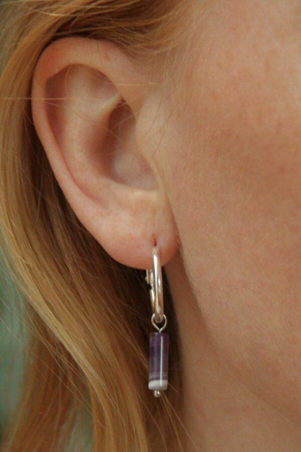 groove-is-in-the-heart-oorbellen-zilver-lila-rooi.jpg